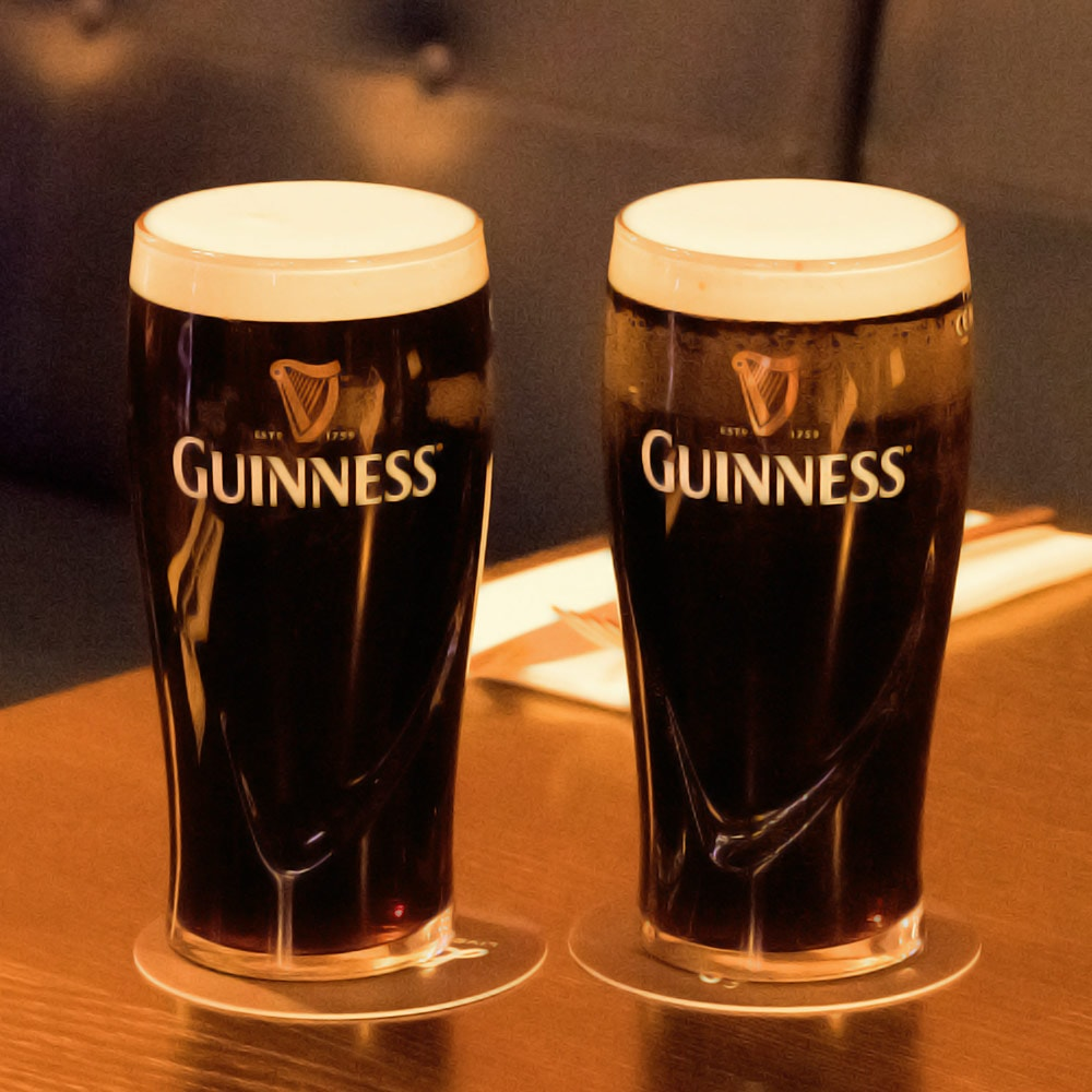 Two pints of Guinness on a table