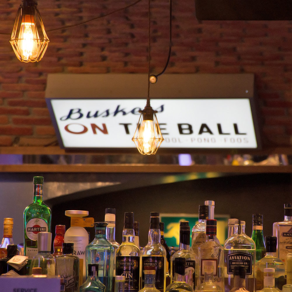 A bar with a Buskers on the Ball sign on the wall