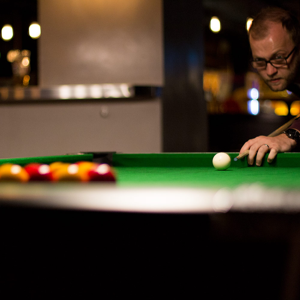 Close up of a man playing pool
