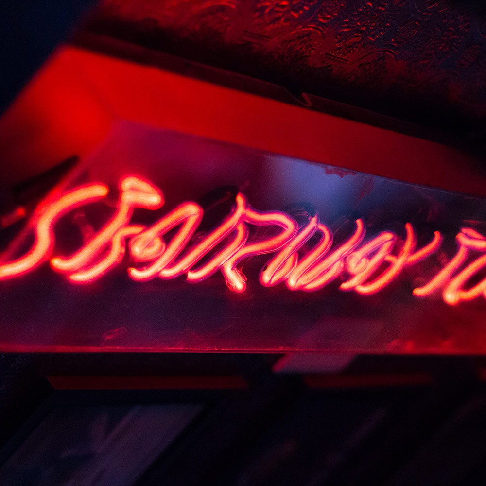 A red lit up sign saying 'Stairway to Heaven''