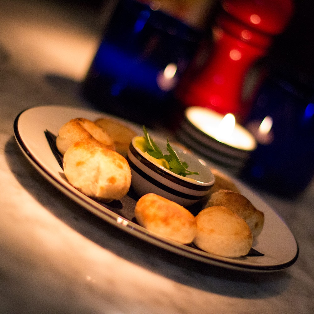 A plate of dough balls on a table