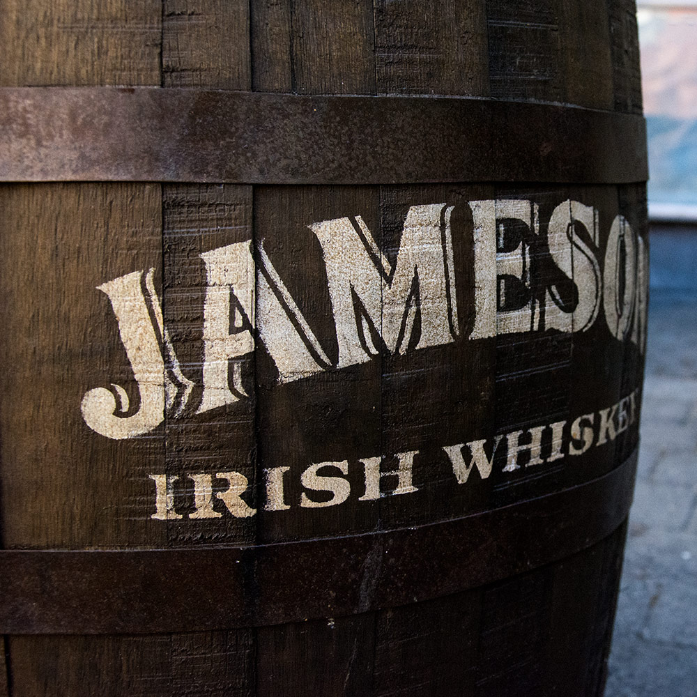 The side of a whiskey barrel saying Jameson Irish Whiskey