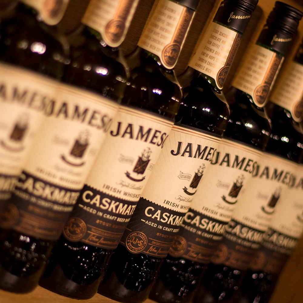 A line of Jameson Whiskey bottles on a shelf