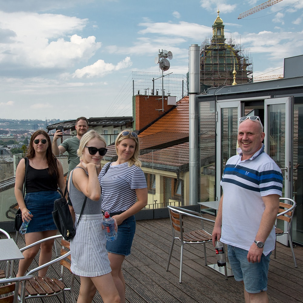 People stood on the roof of an apartment in Prague