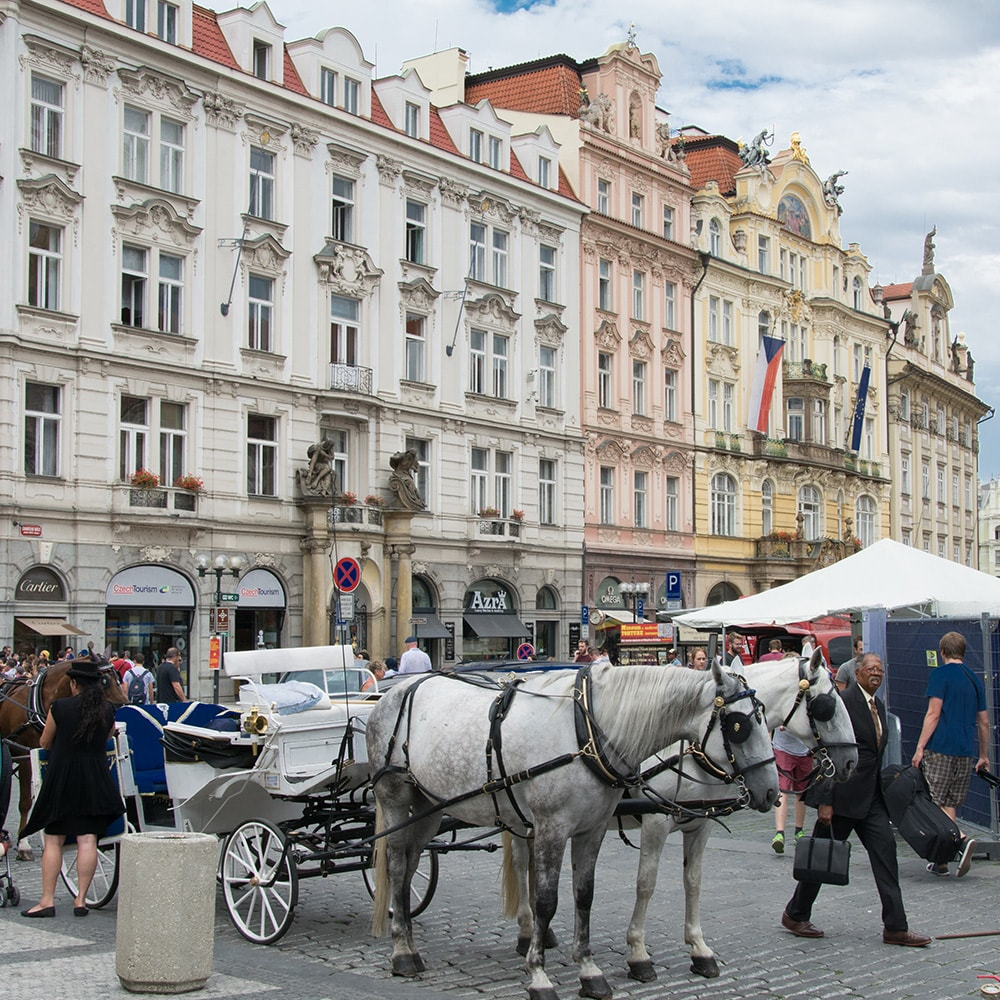 A horse and carriage in the square in Prague