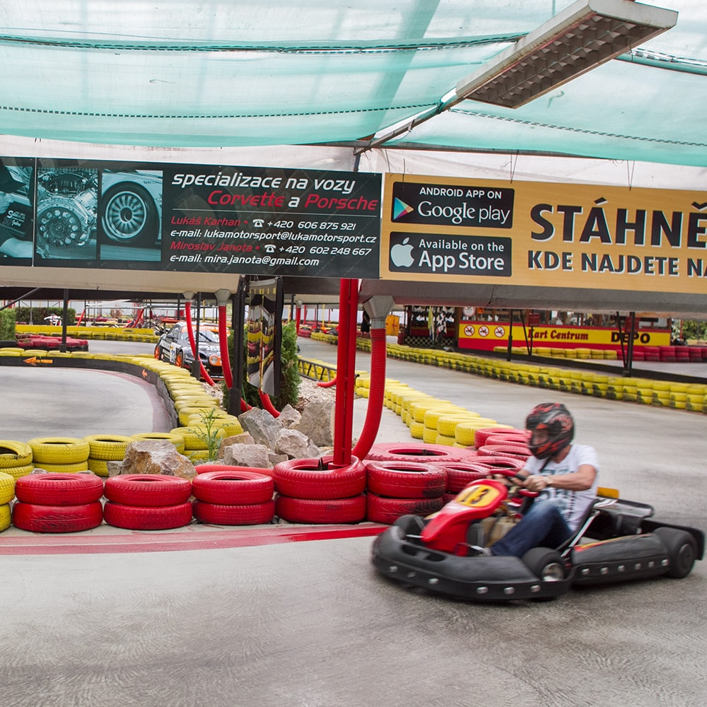 A person driving a kart in Prague's indoor karting centre