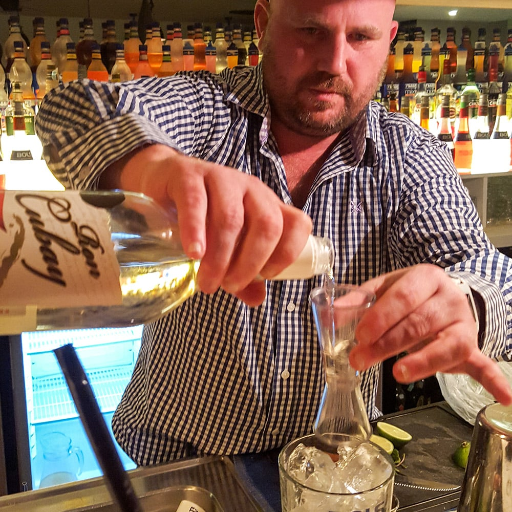 A man making a cocktail