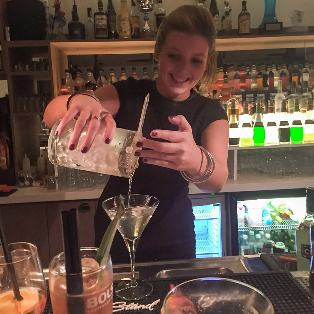 A girl making a cocktail