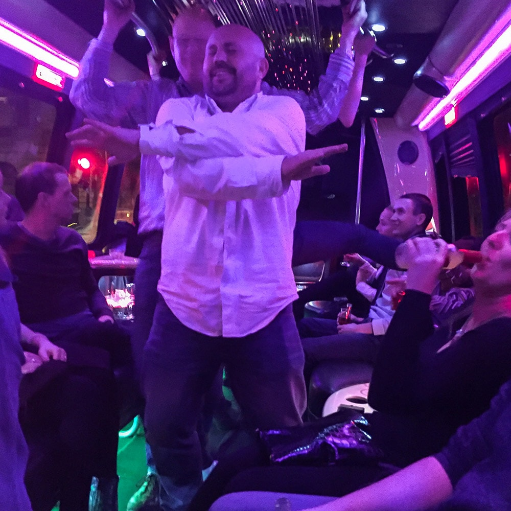 Some men dancing in a strip limo