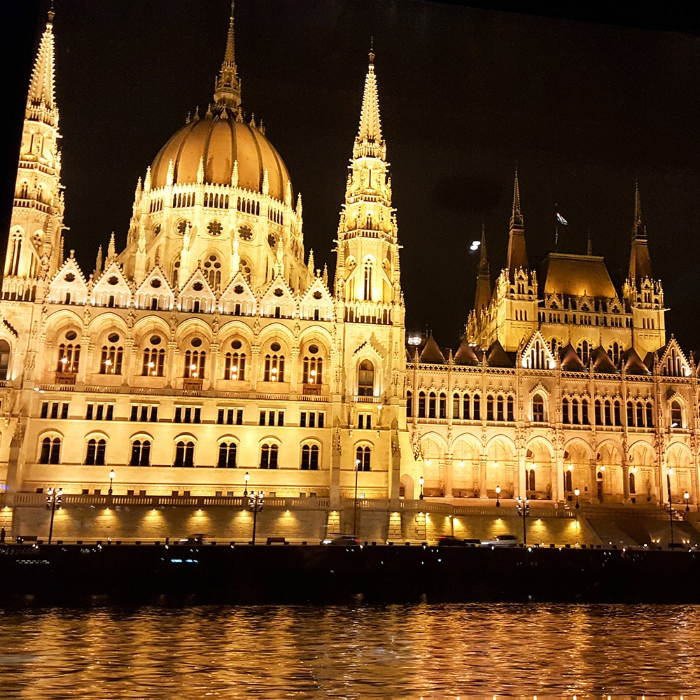 An illuminated building in Budapest