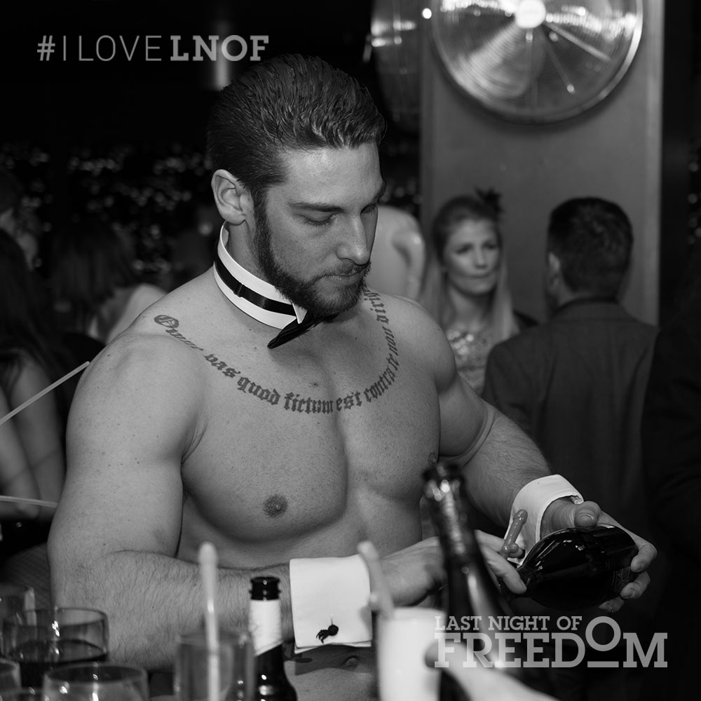 A butler in the buff pouring a drink
