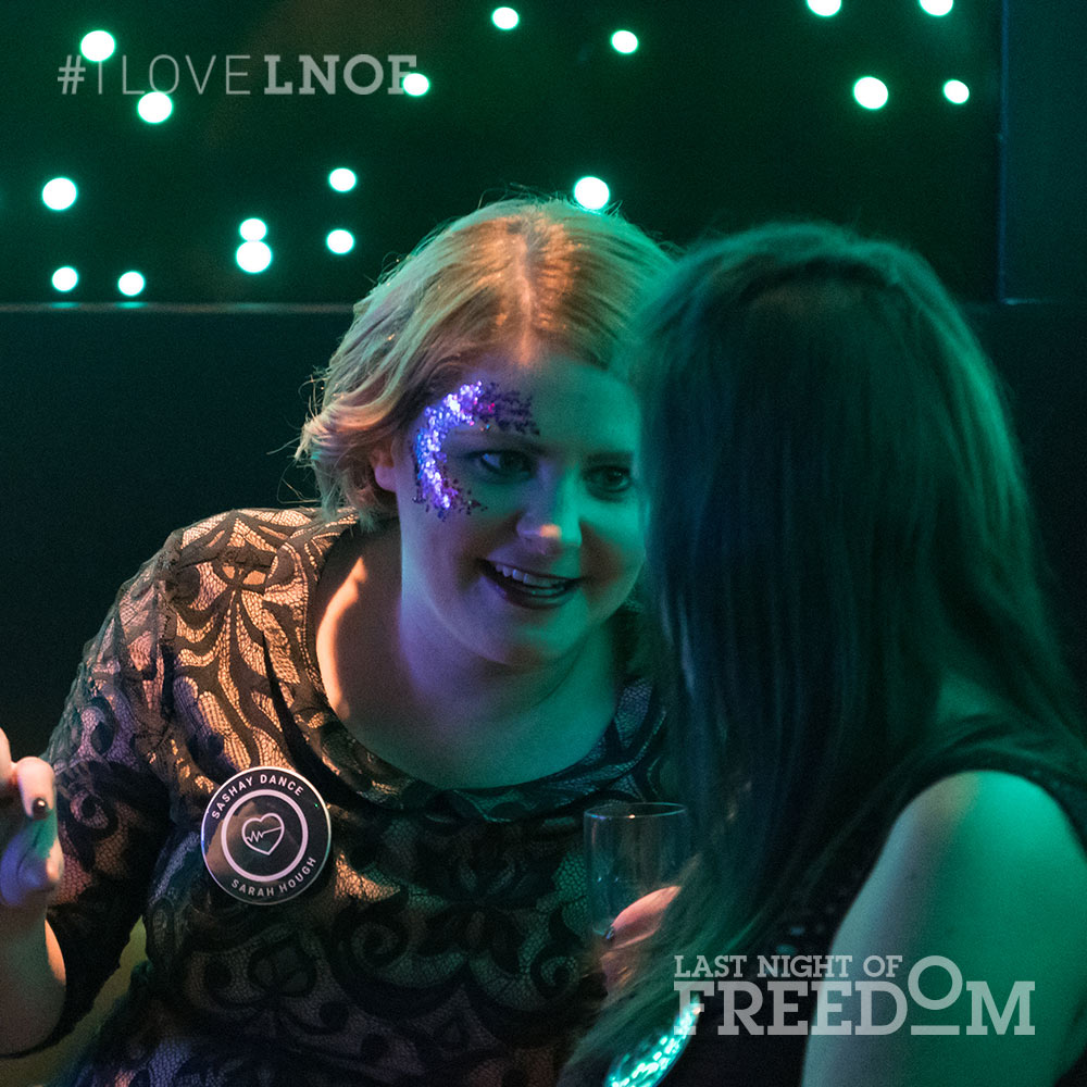 Two girls talking in a nightclub
