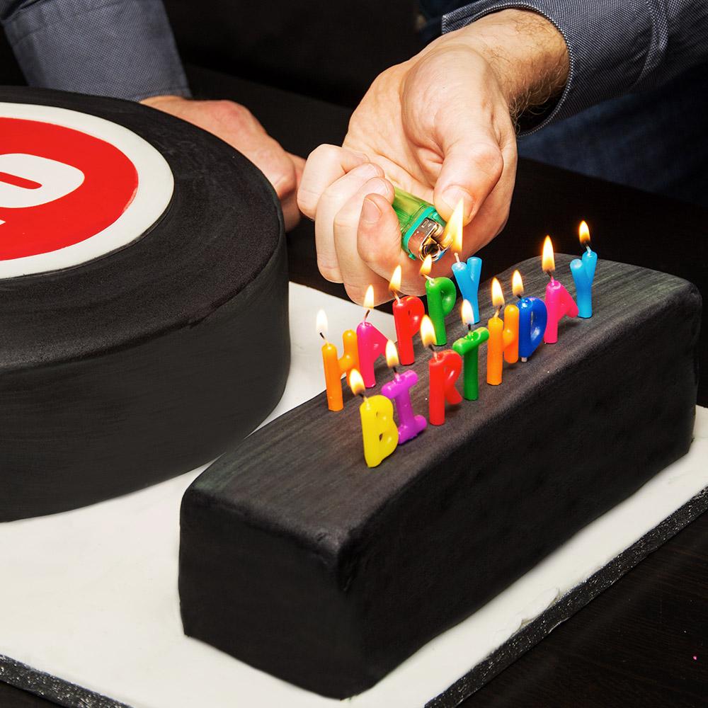 Matt lighting the birthday candles