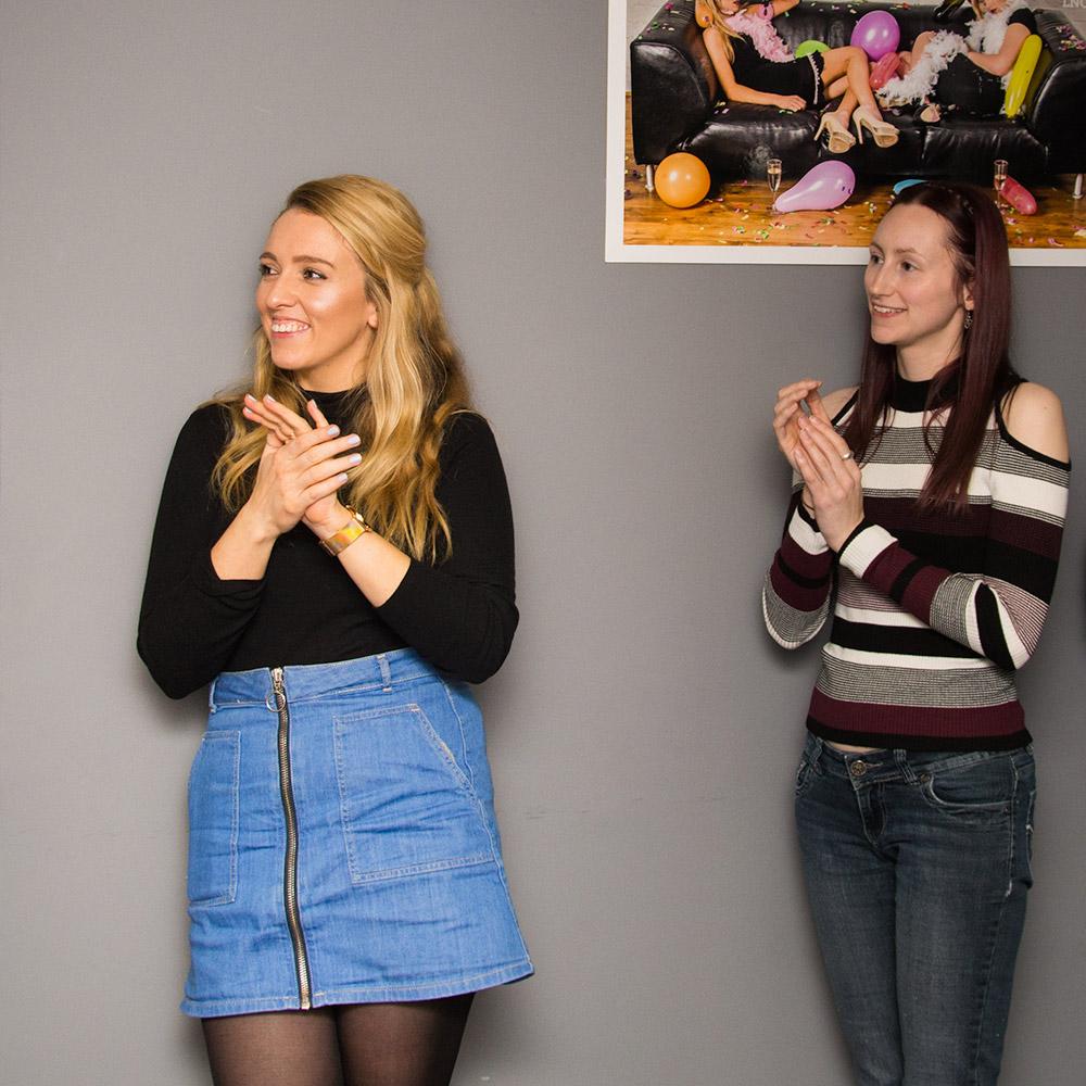Two girls clapping at Matt's speech
