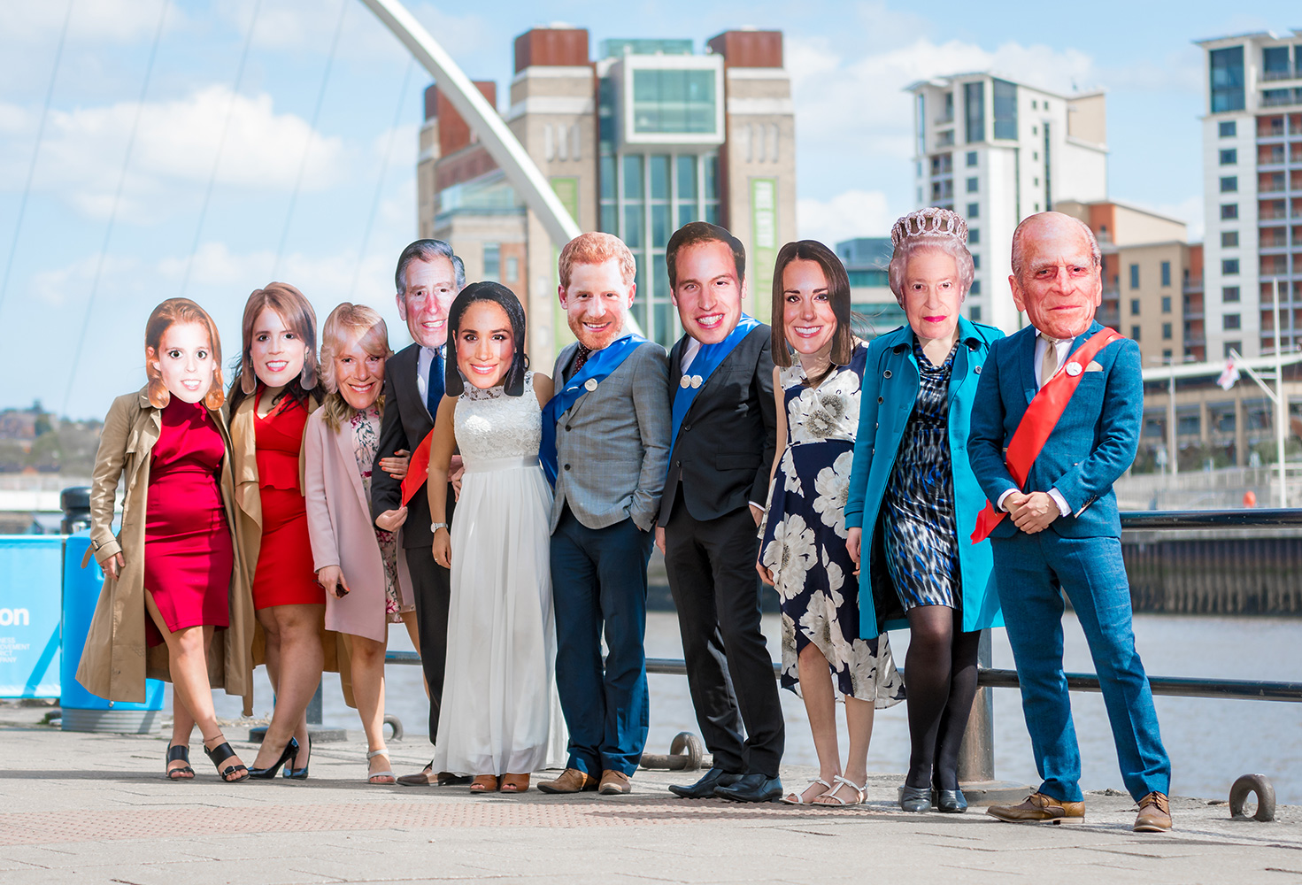 People wearing Royal Family masks on Newcastle's Quayside