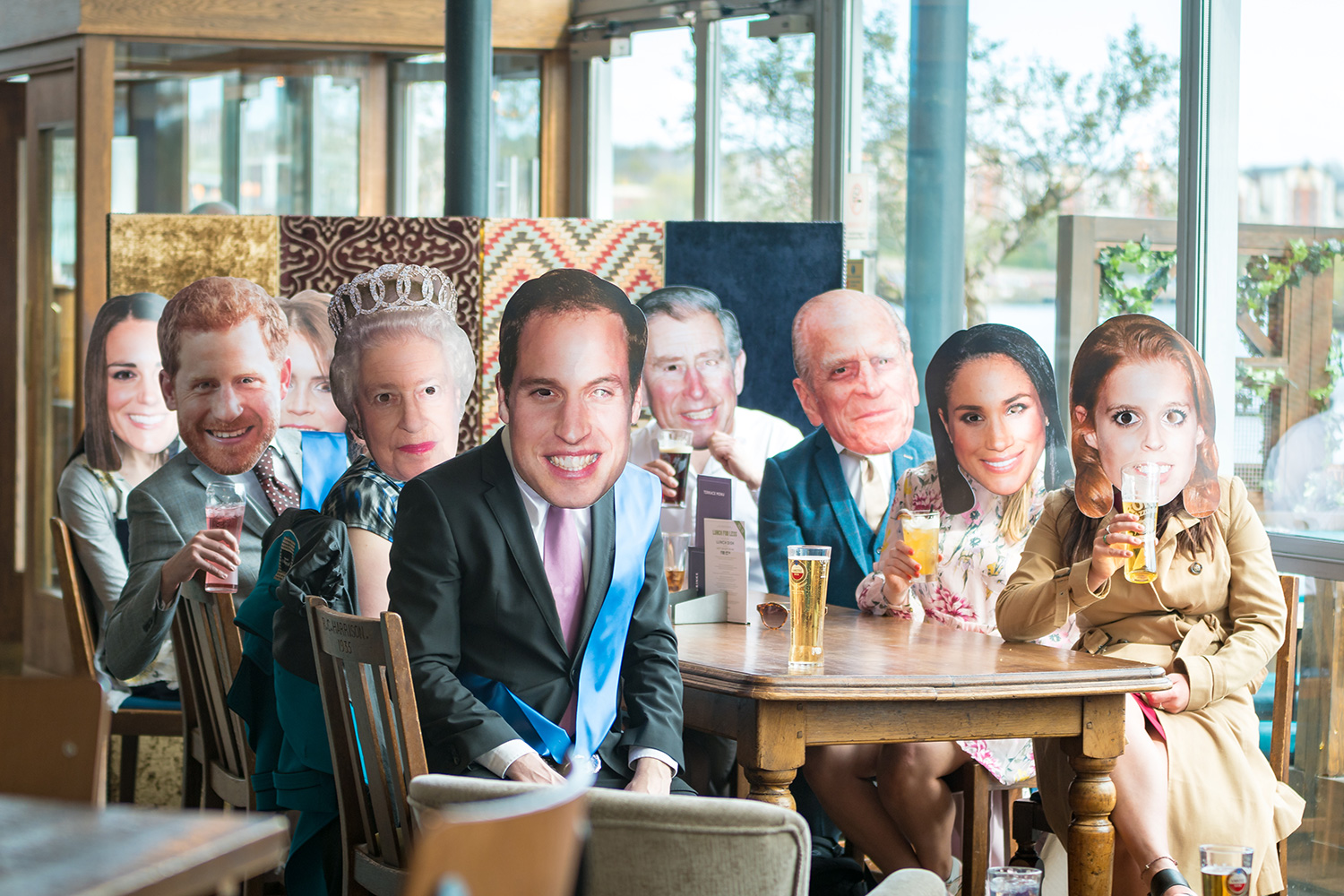 A group of people wearing Royal Family masks in Pitcher and Piano in Newcastle
