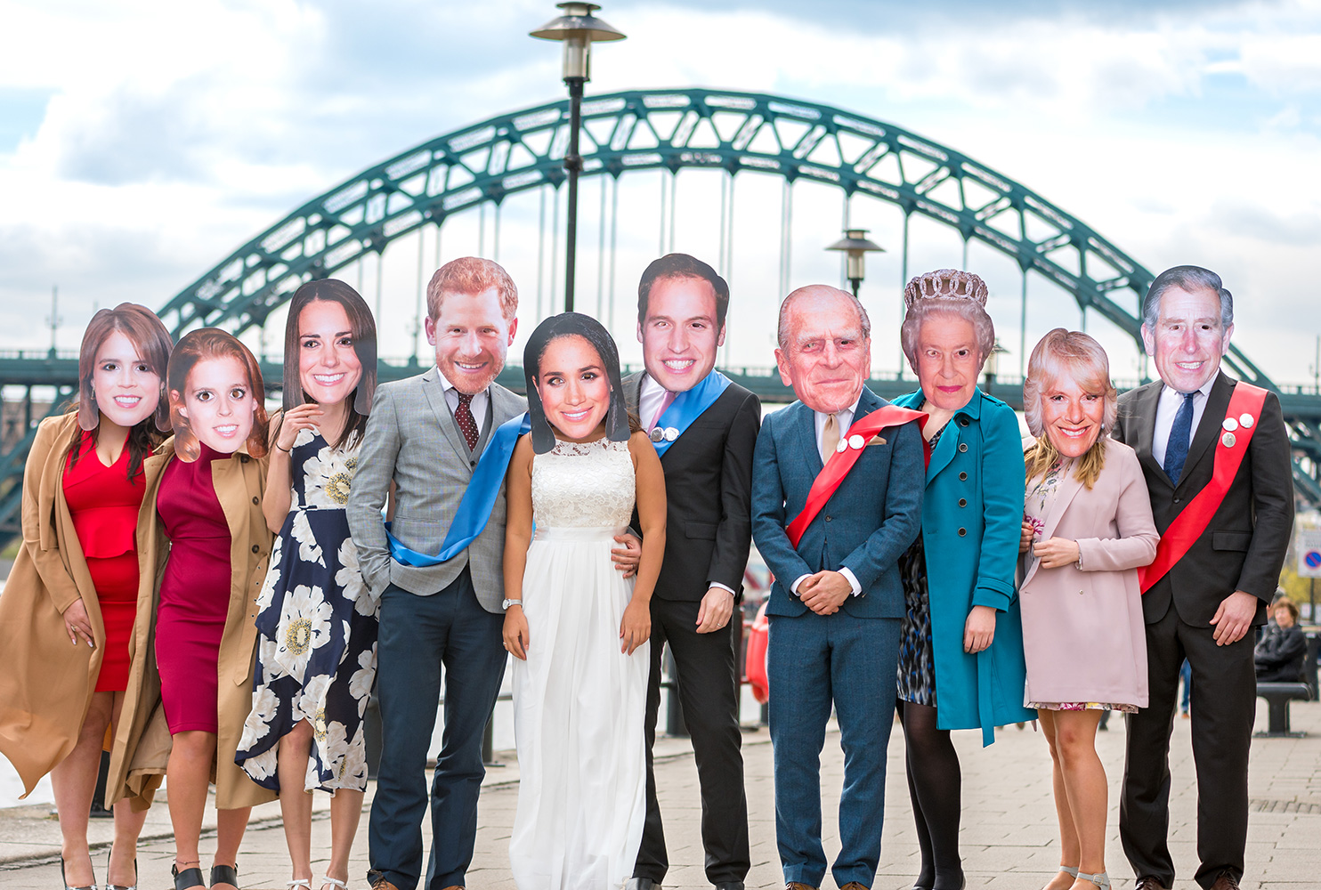 Last Night of Freedom staff wearing Royal Family masks in front of the Tyne Bridge in Newcastle