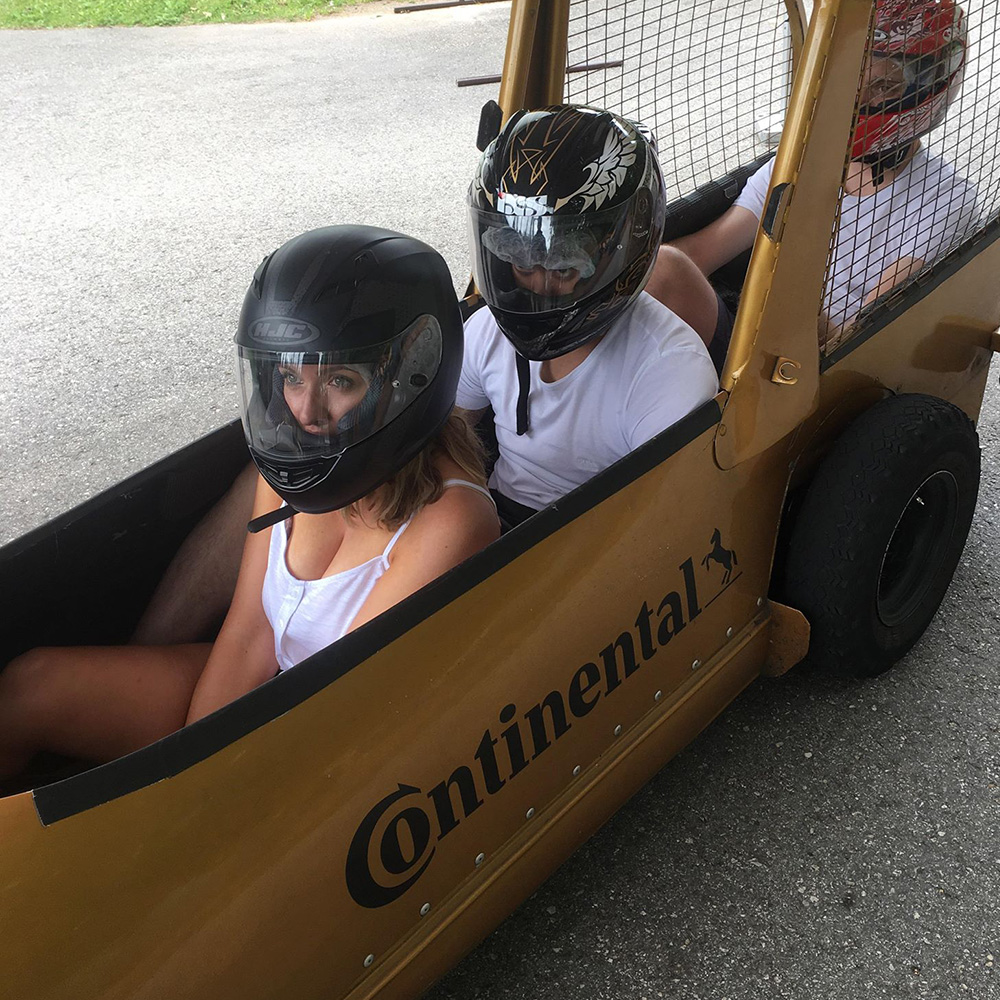 Three people in a bobsleigh