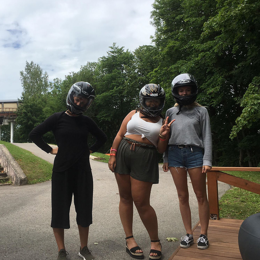 Three girls with their helmets on