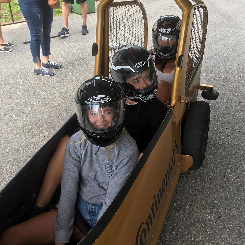 Three girls in a bobsleigh