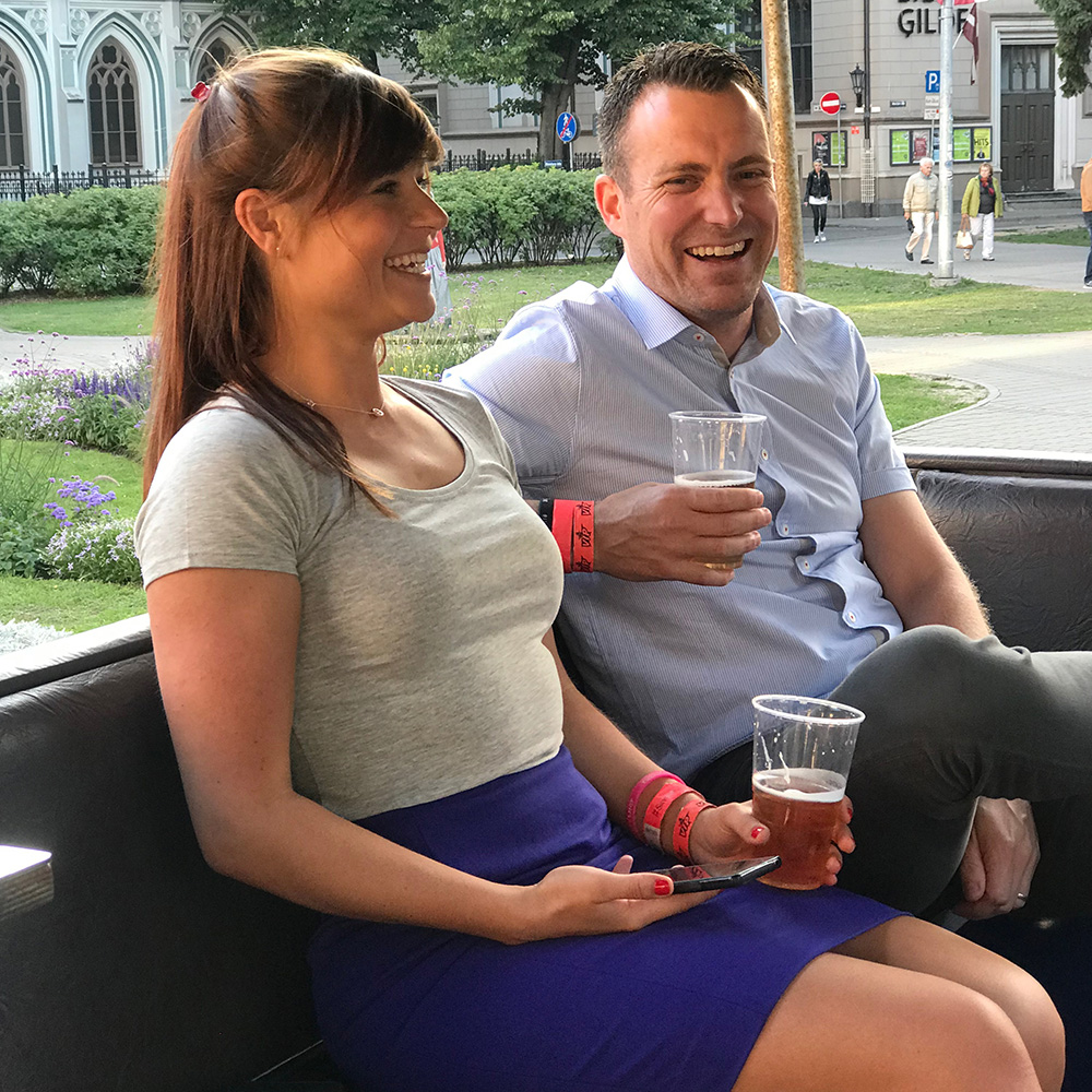 Two people sitting on a beer bike