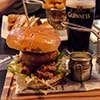 Close up of a pulled pork burger, served on a wooden board
