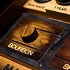 Close up of a wooden block with the word Bourbon on