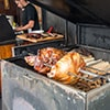 Roast pig on a spit in a street stall in Prague