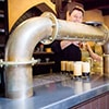 A bartender pulling pints of beer at U Fleku brewery