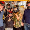 Five people posing for a picture in helmets at Prague's karting centre