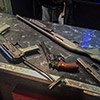 Some guns lying on a table