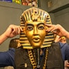 A man with an Egyptian mask on