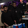 Some men playing beer pong