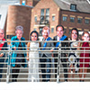 Last Night of Freedom staff wearing Royal Family masks on the Millenium Bridge on Newcastle's Quayside