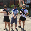 Three people holding laser guns