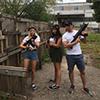 Three people holding laser guns outdoors