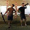 Two men holding guns