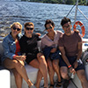 Four people on a yacht