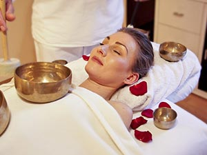 A woman receiving a relaxation treatment