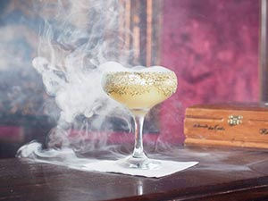 A smoking cocktail in a martini glass