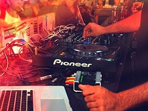 A DJ's hands on the decks