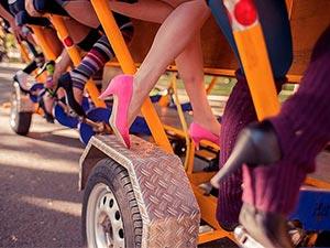 Some women's legs on a wine bike