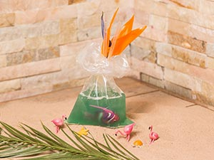A green cocktail in a bag, with a plastic purple fish in