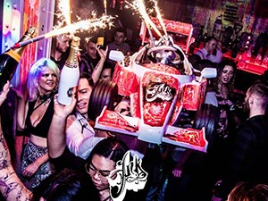 People carrying a go kart with sparklers coming out of it, in Liverpool's Ink Bar