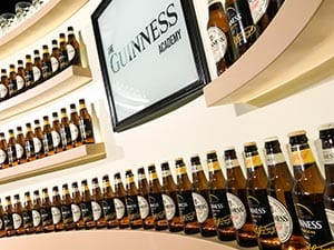 Some bottled Guinness lining the semi-circular walls of The Guinness Academy