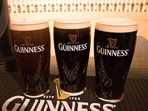 Three glasses of Guinness at different stages of settling