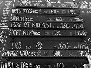 A blackboard with different craft beers written on