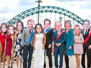 A group of Last Night of Freedom staff dressed in Royal Family masks on the Quayside