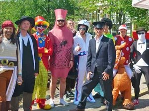 A group of stags in fancy dress, by the canal in Amsterdam