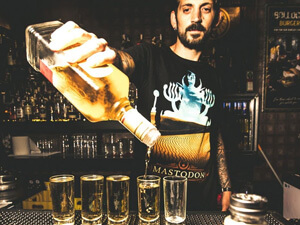 A bartender serving shots